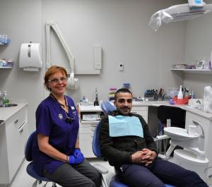 Dentist with patient at the Central Dental Surgery