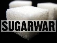 "A graphic that says ""Sugar war"""